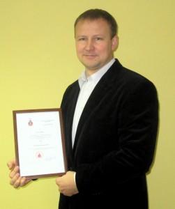 """Dyplom dla iCargo: """"Produkt informatyczny roku 2014"""" w rękach prezesa"""